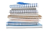 Stack of spiral notebooks with a blue pen