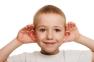 little boy listening