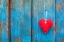 red heart on blue wood